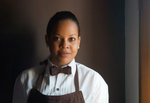Image of a young african american woman in her work uniform.