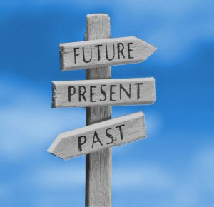 """Image of a sign with the words """"past,"""" """"present,"""" and """"future."""""""